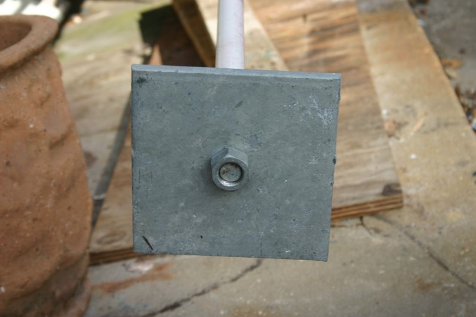 6x6 plate on hot dipped galvanized threaded rod as opposed to black steel bent 90 degrees in the field.